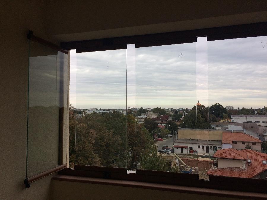 Sisteme de inchidere terase si balcoane cu sticla glisanta securizata
